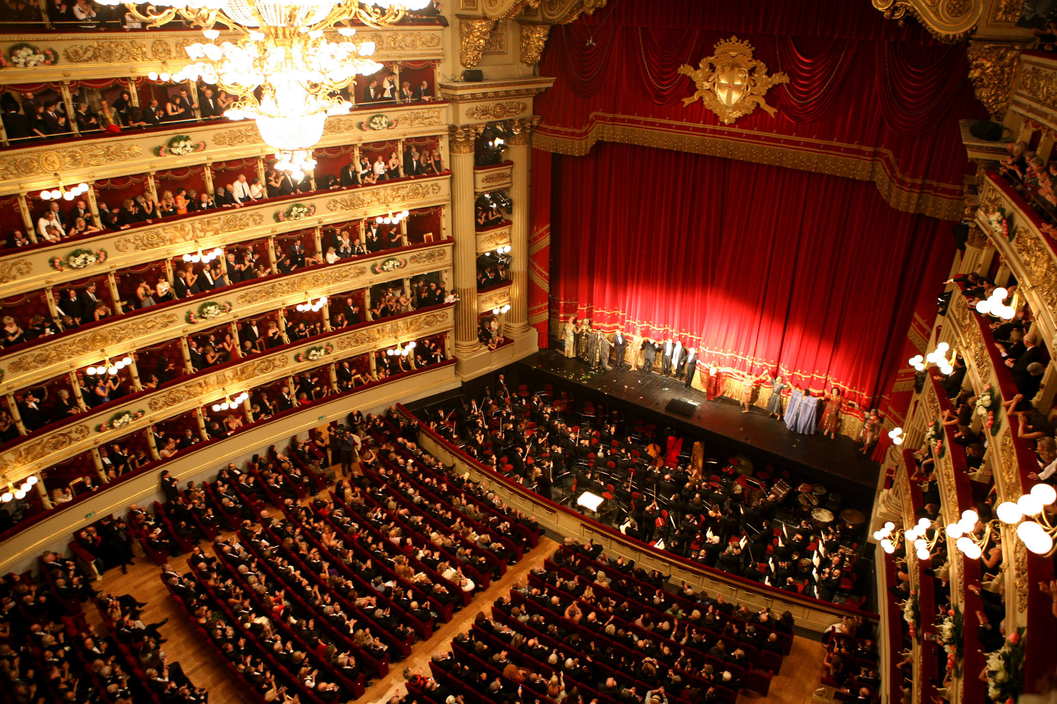 """** FILE **In this photo released by Teatro alla Scala, the cast of Giuseppe Verdi's """"Aida"""" acknowledges the applause at the end of the opera at La Scala theater, in Milan, Italy, Thursday, Dec. 7, 2006. La Scala canceled a long-awaited performance of Verdi's ''Requiem'' conducted by Daniel Barenboim due to a strike by the opera house's 800 employees. The ''Requiem'' performance scheduled for Friday, Nov. 9, 2007 was to cap a year of commemorations marking the 50th anniversary of the death of Arturo Toscanini and mark one of Barenboim's first appearances in his new role as La Scala's principal guest conductor, was called off. (AP Photo/Marco Brescia/Teatro alla Scala) / SCANPIX Code: 436"""